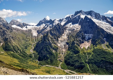 Closeup mountains scenes in national park Dombai, Caucasus, Russia, Europe. Sunshine weather, blue color sky, far away green tree forest. Colorful summer day, time. Print poster, image, photo, picture