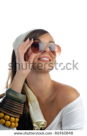 Closeup of a beautiful happy girl with sunglasses isolated on white with copy space
