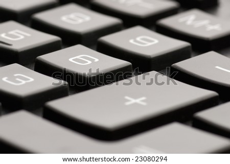 Closeup of a black calculator keyboard - Shallow DOF, low angle view