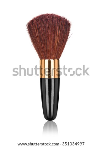 closeup of a blush brush with reflection on an isolated white background