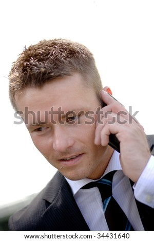 Closeup Of A Handsome Corporate Man With Cellular Phone