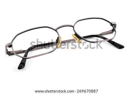 closeup of a pair of metal-rimmed eyeglasses on a white background