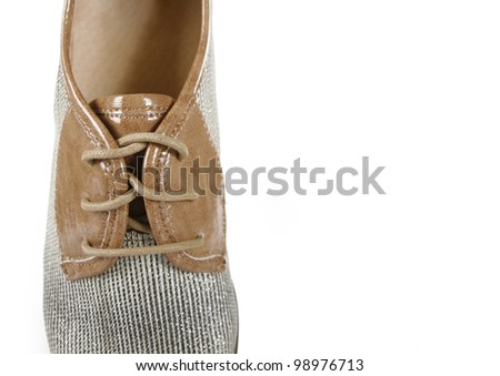 closeup of a patent leather shoe isolated on a white background