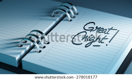 Closeup of a personal agenda setting an important date representing a time schedule. The words Great Night written on a white notebook to remind you an important appointment.