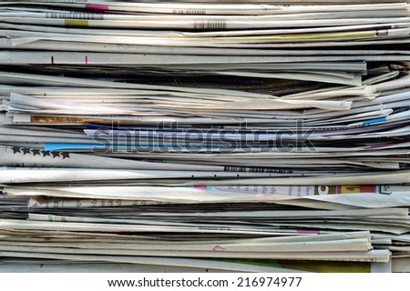 Closeup of a pile of newspapers / A pile of newspapers
