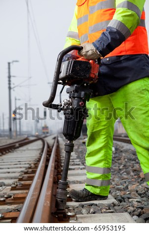 closeup of a railroad worker and a machine