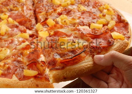Closeup of a sliced pizza