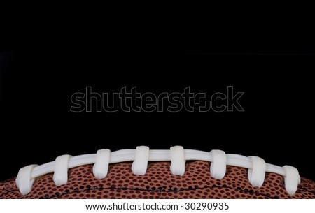 closeup of american football isolated on black