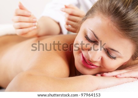 Closeup of an attractive young woman receiving massage