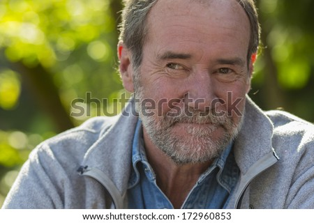 Closeup of an older man outside