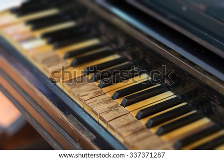 Closeup of antique piano keys