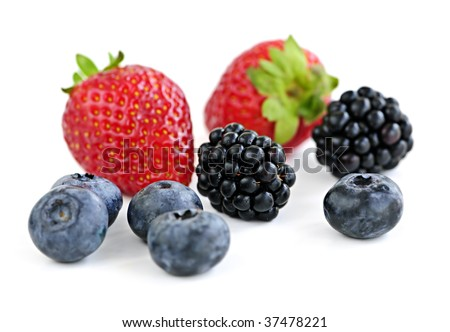 Closeup of assorted fresh berries isolated on white background