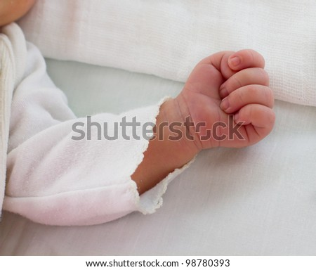 Closeup of baby hand while sleep.
