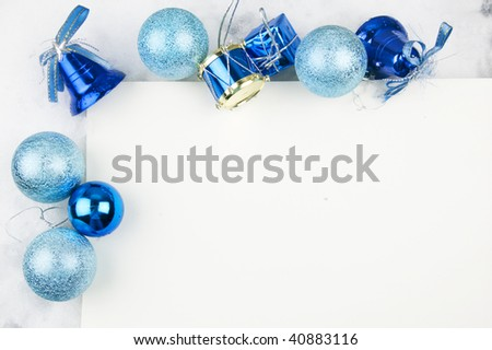 Closeup of blue Christmas Tree decorations on snow