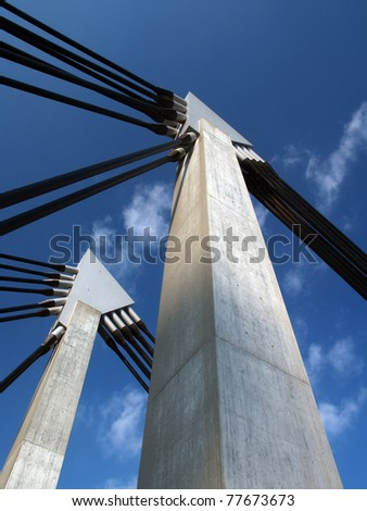 closeup of bridge construction over blue sky