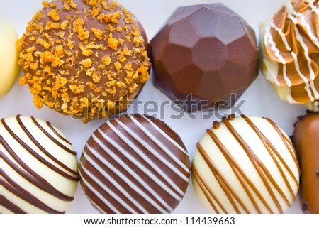 Closeup of different kinds of Belgian chocolates in two rows
