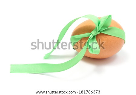 Closeup of Easter egg with green ribbon for gift, Easter decoration. Isolated on white background