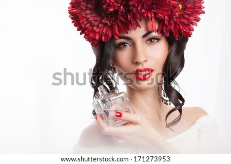 Closeup of fashionable model with perfume bottle