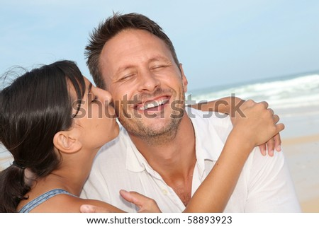 Closeup of father and daughter at the beach