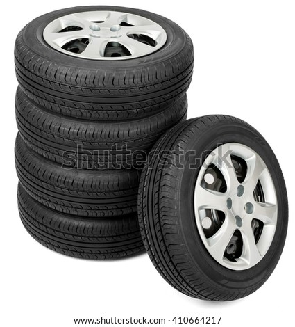 Closeup of five tires, isolated over white background. Top view