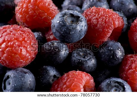 Closeup of fresh blueberries and raspberries mixed together