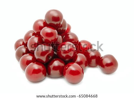 Closeup of fresh sour cherries isolated over white