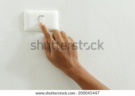 closeup of hand touch electric-switch