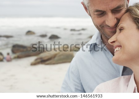 Closeup of happy loving couple spending leisure time together at beach
