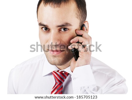 Closeup of happy young man using mobile phone against white background