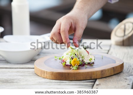 Closeup of Human hands cooking  in kitchen