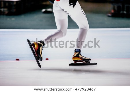 closeup of legs of women speed skaters at competitions in speed skating