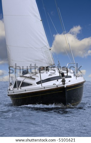 Closeup of little sailing yacht, front view.