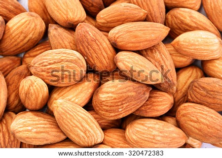 Closeup of Pile of almonds for background.