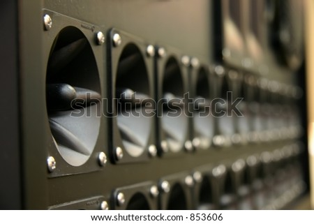 Closeup of row of speaker cones and speakers