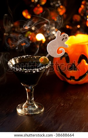 Closeup of Scary Martini, black vodka, vermouth, garnished with olive - Halloween drinks series
