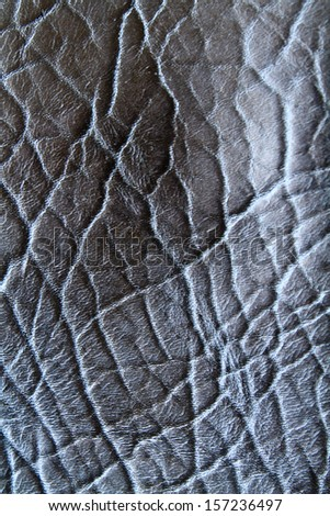 Closeup of seamless black leather texture
