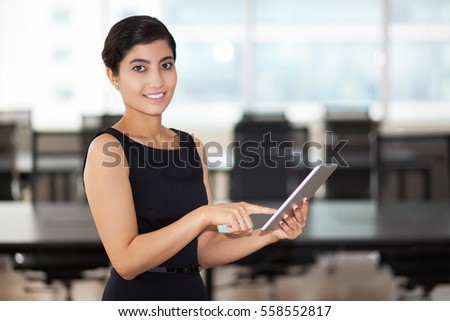 Closeup of Smiling Elegant Asian Lady Using Tablet