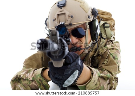 closeup of Soldier  lying on floor with rifle  over white background