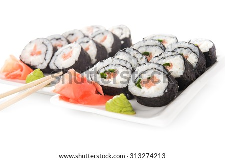 Closeup of sushi rolls with salmon isolated on background