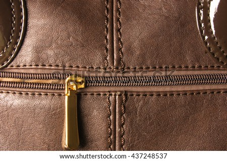 closeup of the seams on brown leather hand bag
