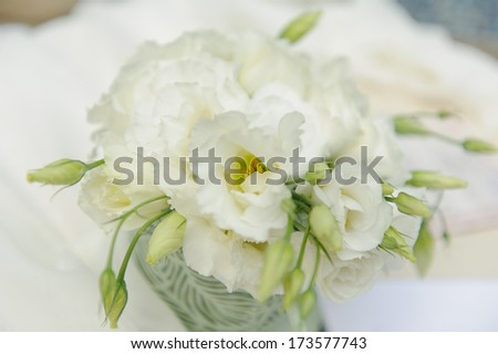 closeup of white flower bouquet on table