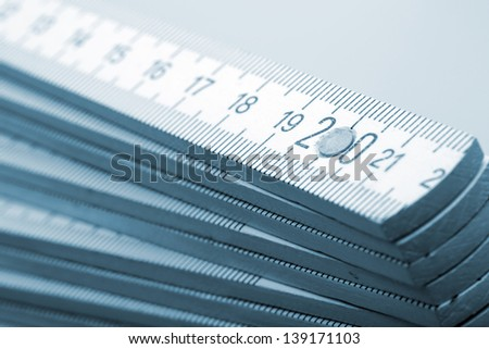 Closeup of wooden rulers. Toned in blue