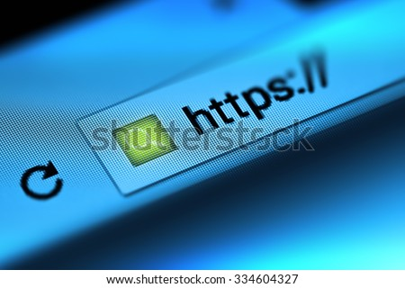 Closeup on the screen with depth of field and focus on the magnifying glass. The image is a security concept in the search engine and web browser address. Hyper Text Transfer Protocol Secure (https).
