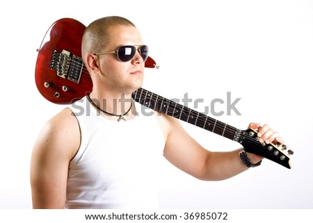 closeup picture of a guitarist with his guitar on shoulder