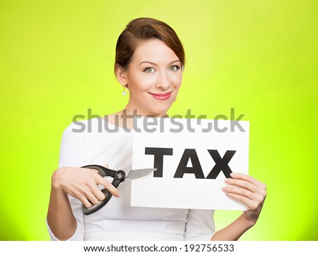 Closeup portrait excited, happy, smiling, energetic, enthusiastic young business woman, funny looking girl, worker, dedicated employee, cutting taxes with scissors, isolated green background. IRS.