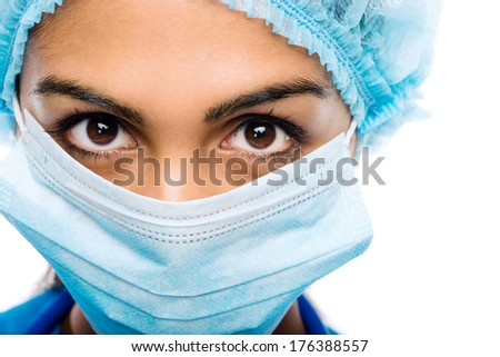 Closeup portrait Indian woman Doctor surgeons serious white background