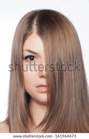 Closeup portrait of a beautiful young woman. Hair care concept. Natural look.