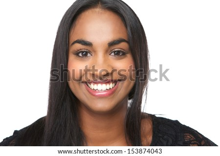 Closeup portrait of a cheerful young woman smiling on isolated white background