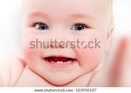 Closeup portrait of adorable smiling baby girl