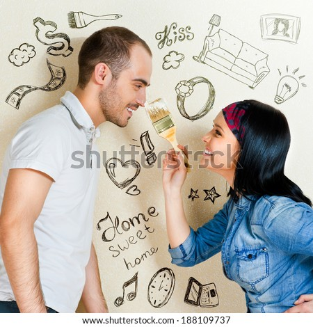 Closeup portrait of adult couple at their apartment renovating of their new apartment